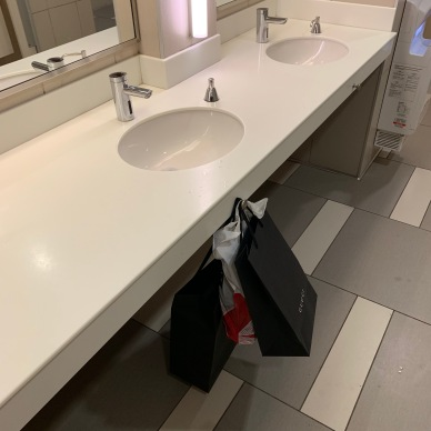 A sink with a hook at Toronto Premium Outlets